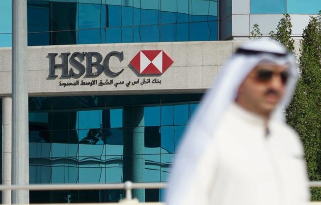 a-pedestrian-walks-in-front-of-hsbc-offices-in-kuwait-city-kuwait-march-30-2016-reuters-stephanie-mcgehee